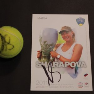 A Maria Sharapova Game-Used & Signed Tennis Match Ball & Signed Champion Card.  2011 WTA Western & Southern Open (Champion).