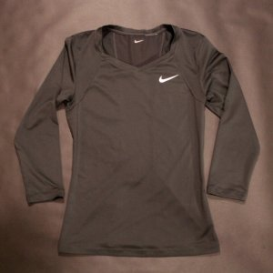 A Maria Sharapova Game-Used Custom Nike Tennis Shirt.  2012/13.