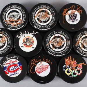 NHL Signed Hockey Puck Lot (10) - Incl. (4) Luc Robitalle, Bobby Clark, Mike Eruzione etc. JSA