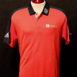A Jason Day Game-Used Custom Adidas Golf Polo Shirt.  2016 Masters (2nd Round of Play).