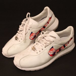 A Pair of Serena Williams Game-Used / Personal Custom Tennis Shoes.  2016 French Open.