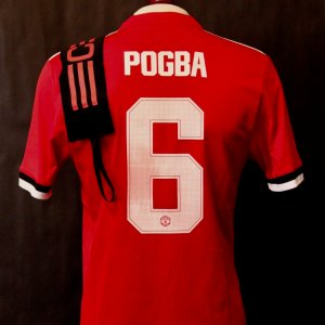 A Paul Pogba Game-Used #6 Manchester United FC Home Shirt & Captain's Armband.  2017 US Tour.