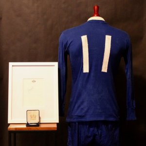 A George Best Game-Used #11 Manchester United FC Uniform (Shirt & Shorts).  Circa 1960's.  Includes Framed Signature & Personal Medal.