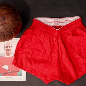 A Pair of Bobby Charlton Game-Used Manchester United Shorts & MUFC Match Ball.  Circa 1960's.