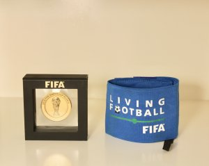 Cristiano Ronaldo Game-Used Portugal World Cup Captain's Armband & FIFA Participation Medal.