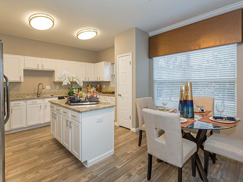 Dining Area & Kitchen | Retreat at Cheyenne Mountain Colorado Apartments