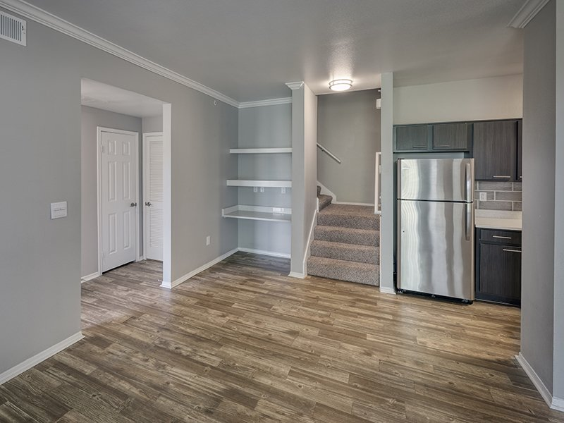 Kitchen and Front Room | Retreat at Cheyenne Mountain Apartments