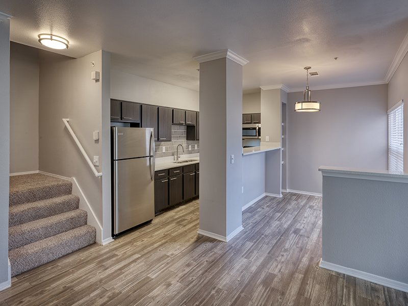 Kitchen and Living Room | Retreat at Cheyenne Mountain Apartments