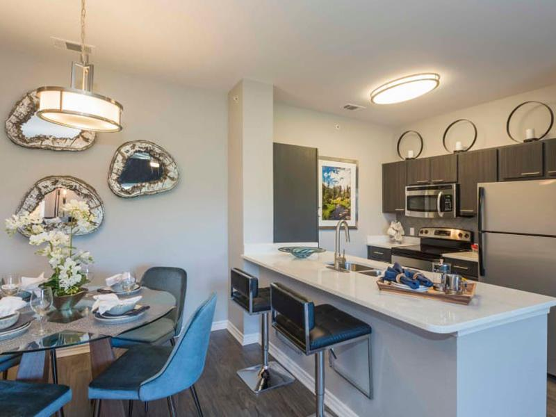 Dining Area & Kitchen | Peaks at Woodmen Apartments