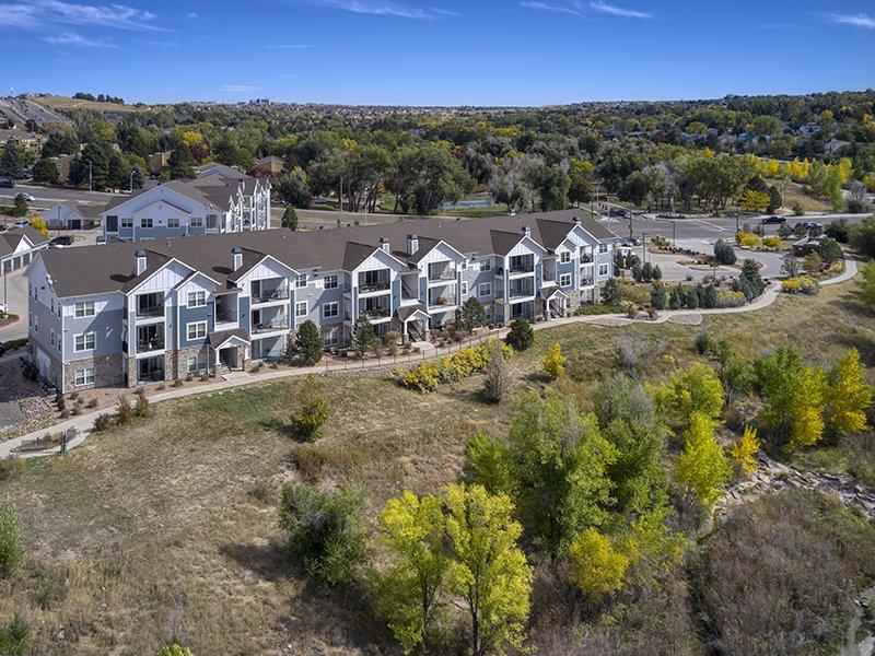 Building Exterior | Peaks at Woodmen Apartments in Colorado Springs, CO