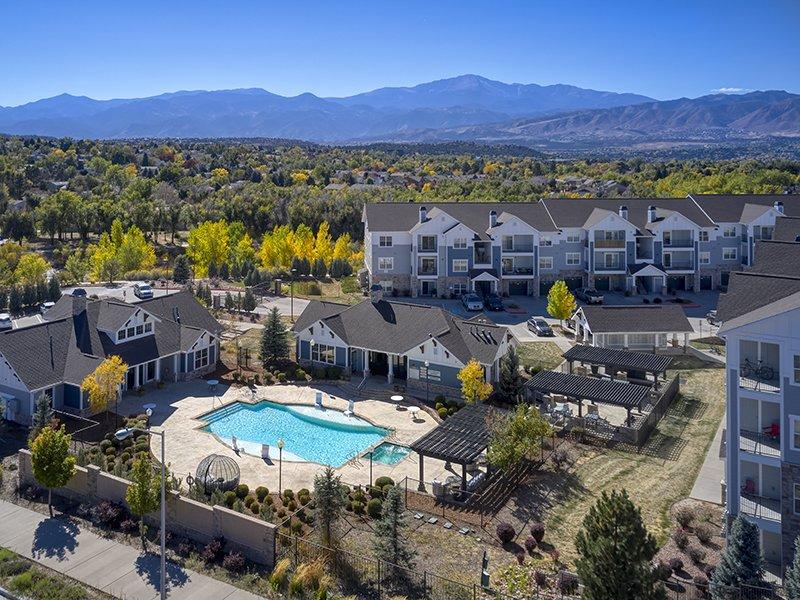 Shimming Pool Aerial View | Peaks at Woodmen Apartments in Colorado Springs, CO