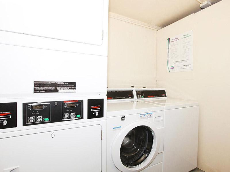 Laundry Facility | Bridge Square Apartments in Brighton, CO