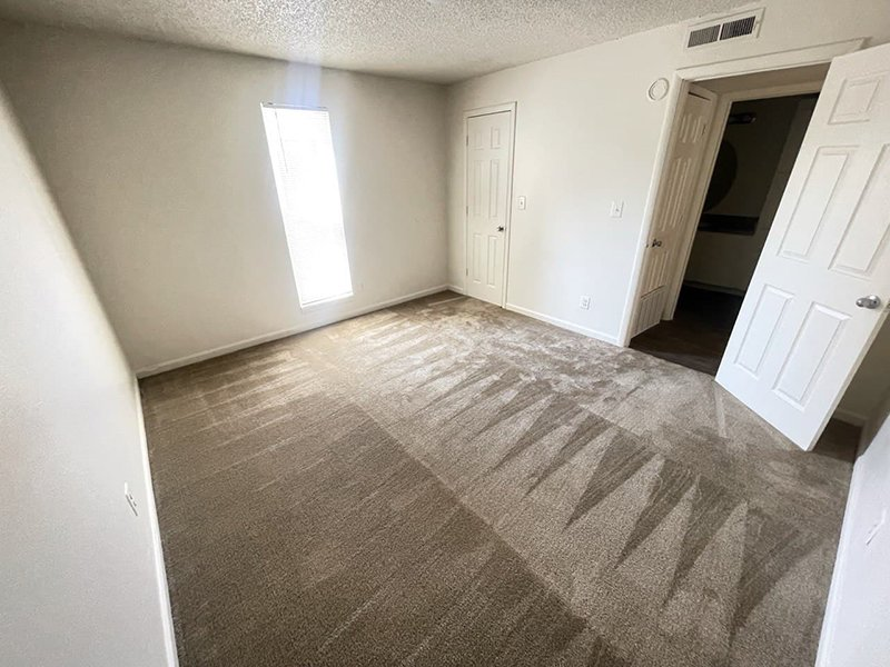 Carpeted Bedroom | Parkview Terrace Apartments in Thornton, CO