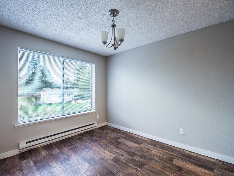 Apartment Dining Room With Window | Pointe East Apartments in Fife WA
