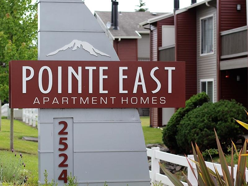 Exterior Welcome Sign | Pointe East Apartments in Fife WA