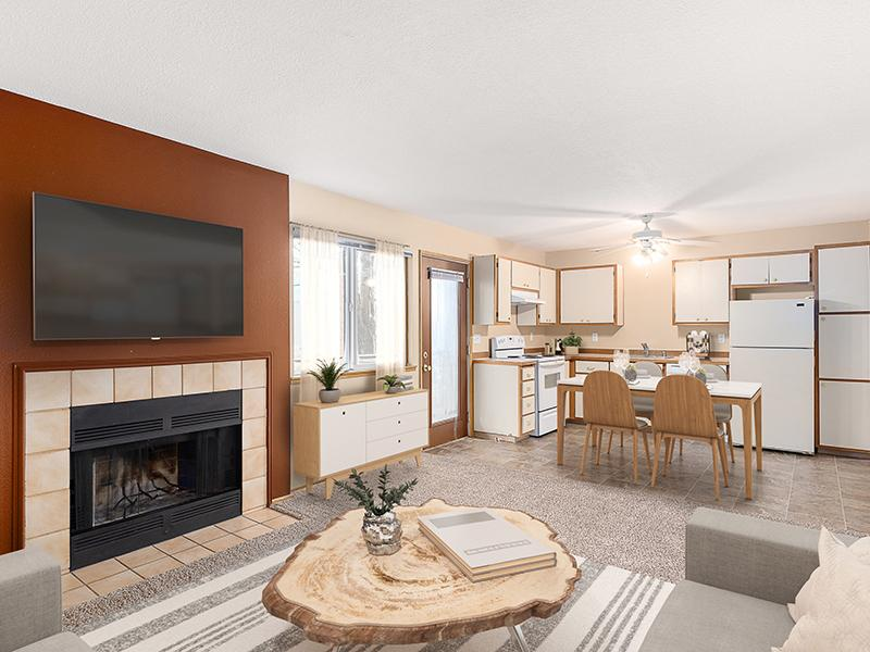 Living Room with a Fireplace | Van Plaza Apartments in Vancouver, WA
