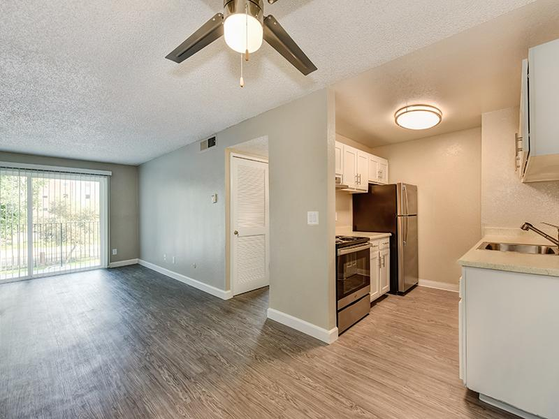 Kitchen & Living Room | Crossings at Wyndham Apartments in Sacramento CA