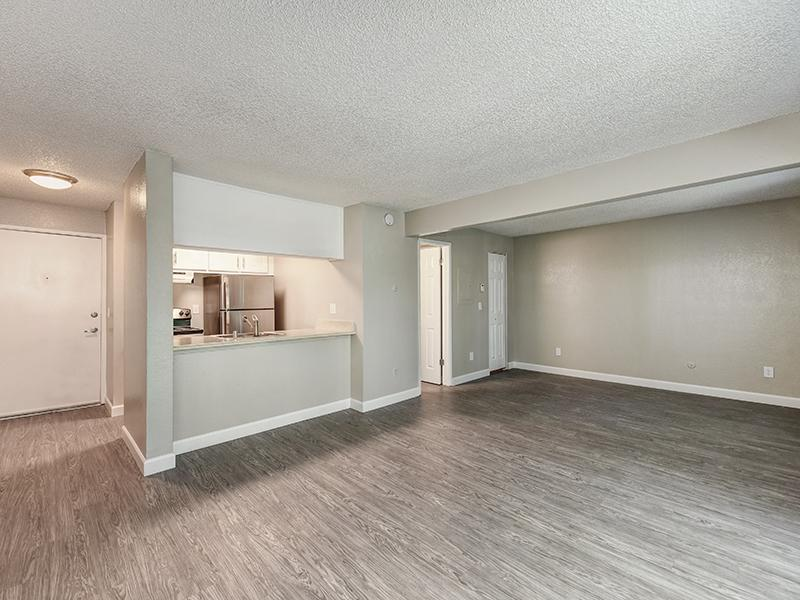 Kitchen and Living Room | The Crossing at Wyndham Apartments in Sacramento, CA