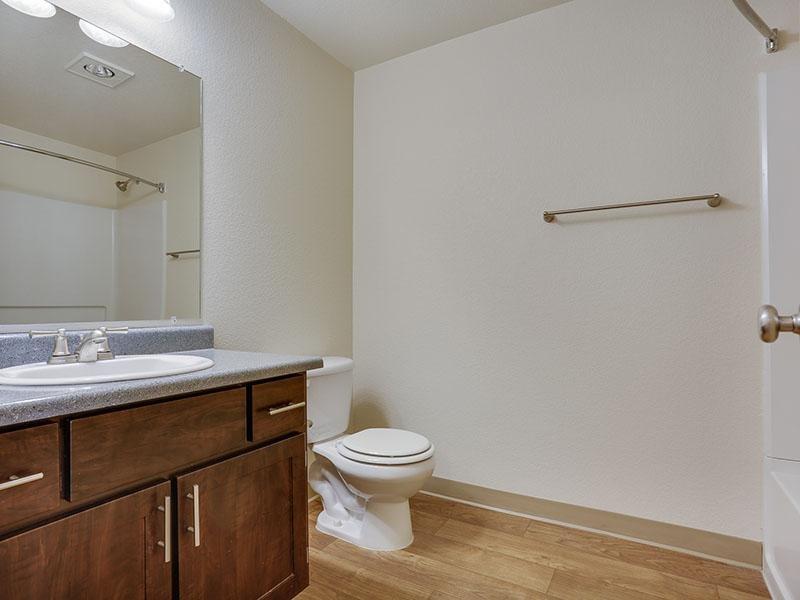 Apartments in Gresham - Stark Street Crossings Bathroom with Wood Style Flooring and Single Sink Vanity