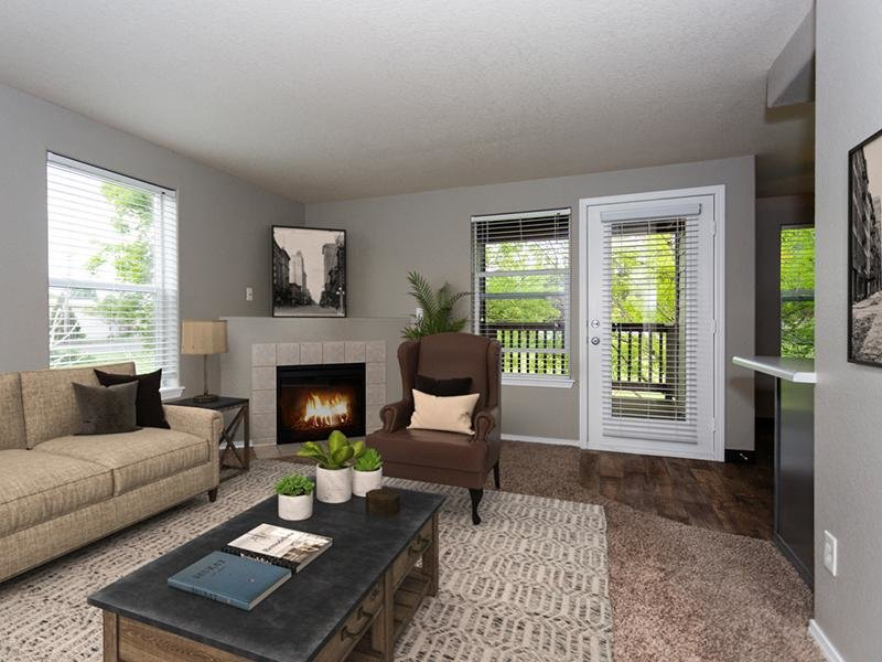 Gresham, OR Apartments - Stark Street Crossings Living Room with a Fireplace and Access to Patio or Balcony
