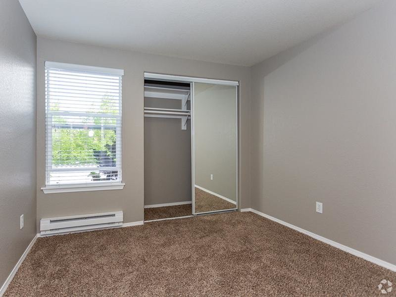 Gresham, OR Apartments for Rent - Stark Street Crossings Bedroom with Spacious Closet and Plush Carpet Flooring