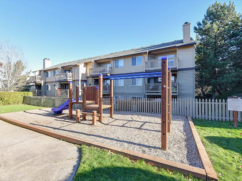 Tot Lot With Exterior Playground | Powell Valley Farms Apartments in Gresham OR