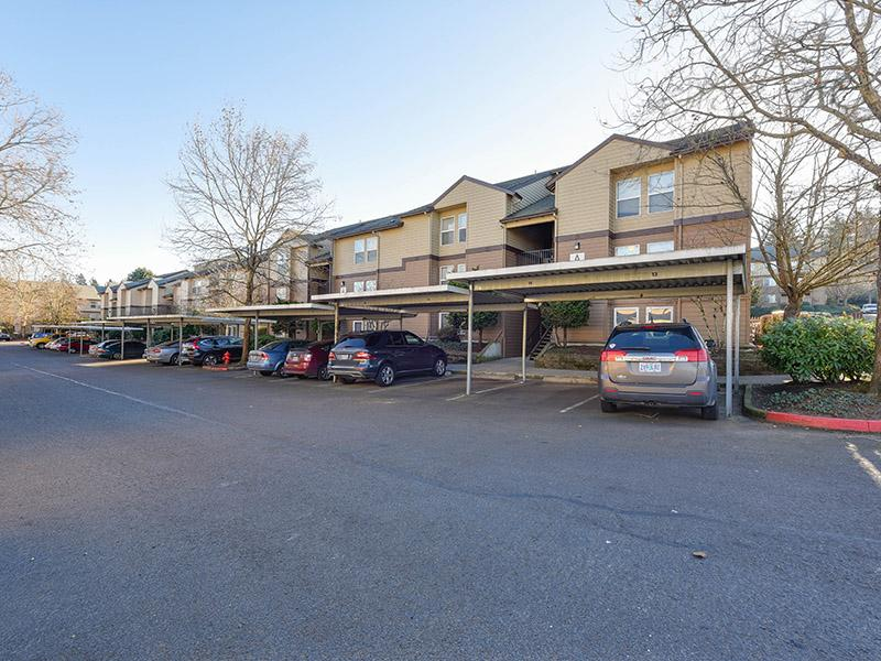 Apartment Building Exterior With Covered Parking | Powell Valley Farms Apartments in Gresham OR