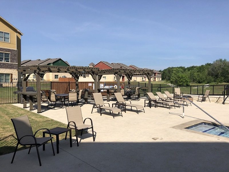 Poolside Seating | Woodlands of Denton Apartments