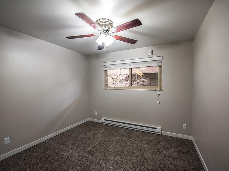 Room w/ Ceiling Fans | Sheridan Beach Terrace 98155 Apartments