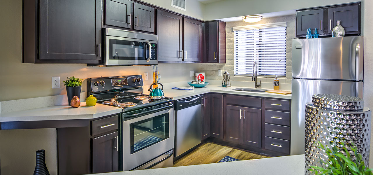 Gourmet Kitchen With Granite Counter Tops, Stainless Or Black Colored  Appliances.