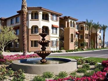 Outside of apartment Building With Fountain | Serafina Apartment Homes