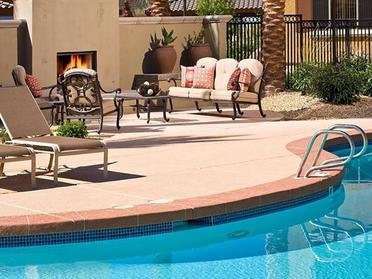 Resort Style Swimming Pool With Fireplace | Serafina Apartments in Goodyear AZ