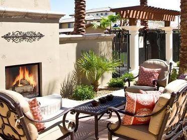 Outdoor Seating area with fireplace | Serafina Apartment Homes