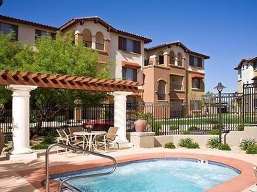 Community Hot Tub With Building Exterior | Serafina Apartments in Goodyear AZ