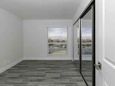 One Bedroom Apartments in Salt Lake City, UT - Foothill Place Apartments Bedroom with a Large Window and Spacious Layouts