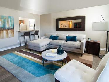 Apartments in Salt Lake City for Rent - Foothill Place Apartments Living Room with Wood Flooring and Eat-In Kitchen Bar