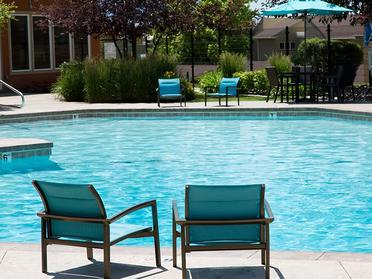 Apartments for Rent Salt Lake City, UT - Foothill Place Apartments Large Relaxing Pool with Lounge Chairs and Couches