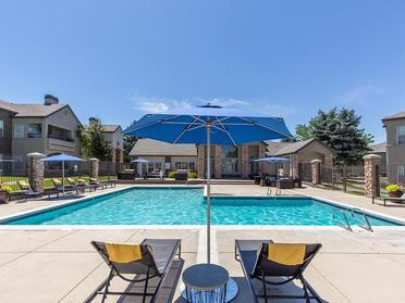 Sandy Apartments for Rent - Alpine Meadows Swimming Pool with Lounge Chairs and Umbrellas
