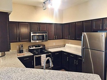 Kitchen and Island | Evergreen at River Oaks