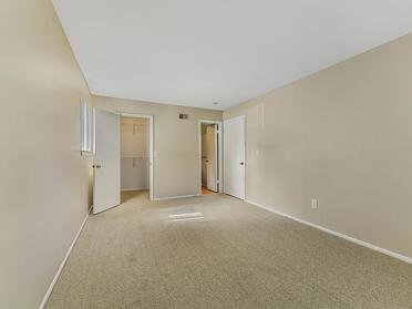 Carpeted Living Room   Township Court Apartments in Saginaw, MI