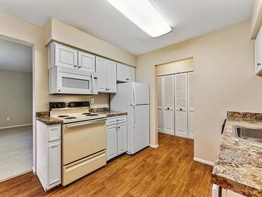 Fully Equipped Kitchen   Township Court Apartments in Saginaw, MI