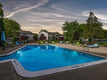 Outdoor Pool   Township Square Apartments in Saginaw, MI