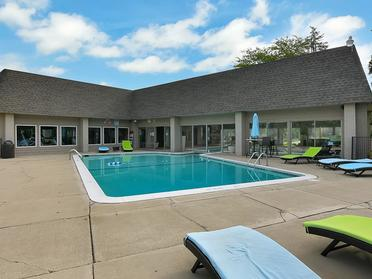 Outdoor Swimming Pool   Township Square Apartments in Saginaw, MI