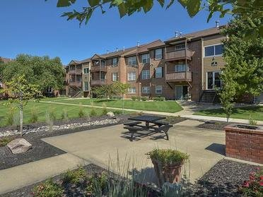 Village 1 Apartments Building Exterior, Outdoor Picnic Area, and Community Grounds