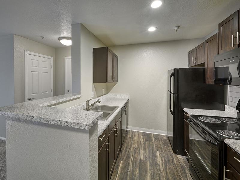 Fully Equipped Kitchen | Echo Ridge at North Hills Apartments in Northglenn, CO