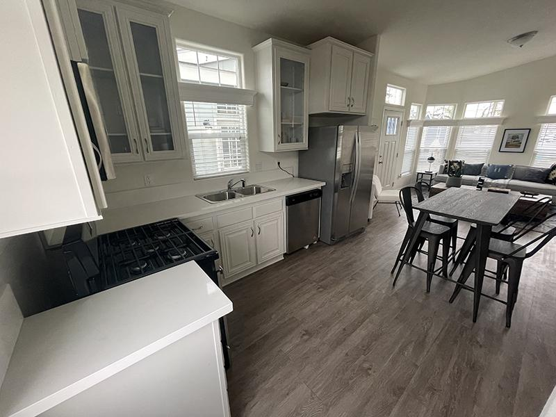 Apartments North Hollywood - Spacious Modern Kitchen With White Cabinets and Countertops, and Sleek Stainless Steel Appliances