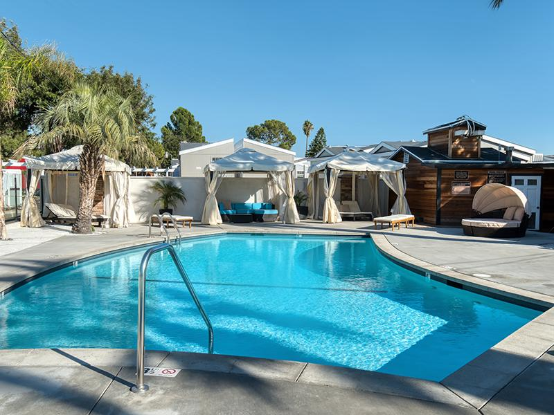 North Hollywood CA Apartments for Rent - Sparkling Swimming Pool With Nearby Cabanas and Lounge Seating