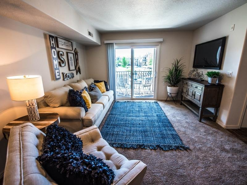 Living Area with Balcony | Settlers Landing