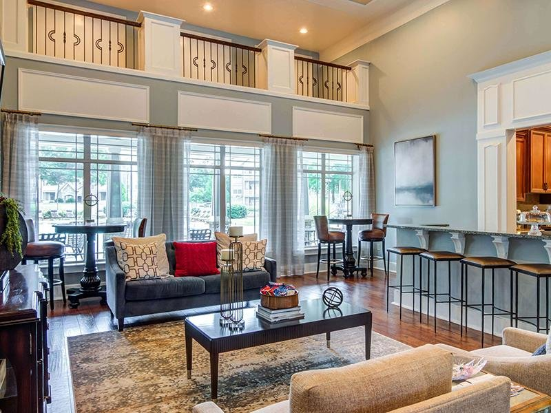 The resident clubhouse is furnished with multiple seating areas at Eagle's Brooke Apartments.