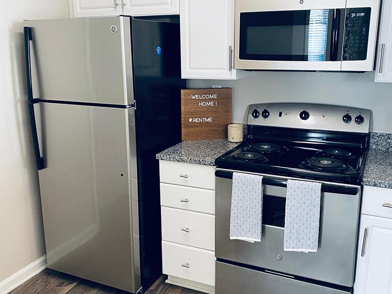Stainless steel refrigerator and stove in the kitchen at The Lakes at Town Center Apartments.